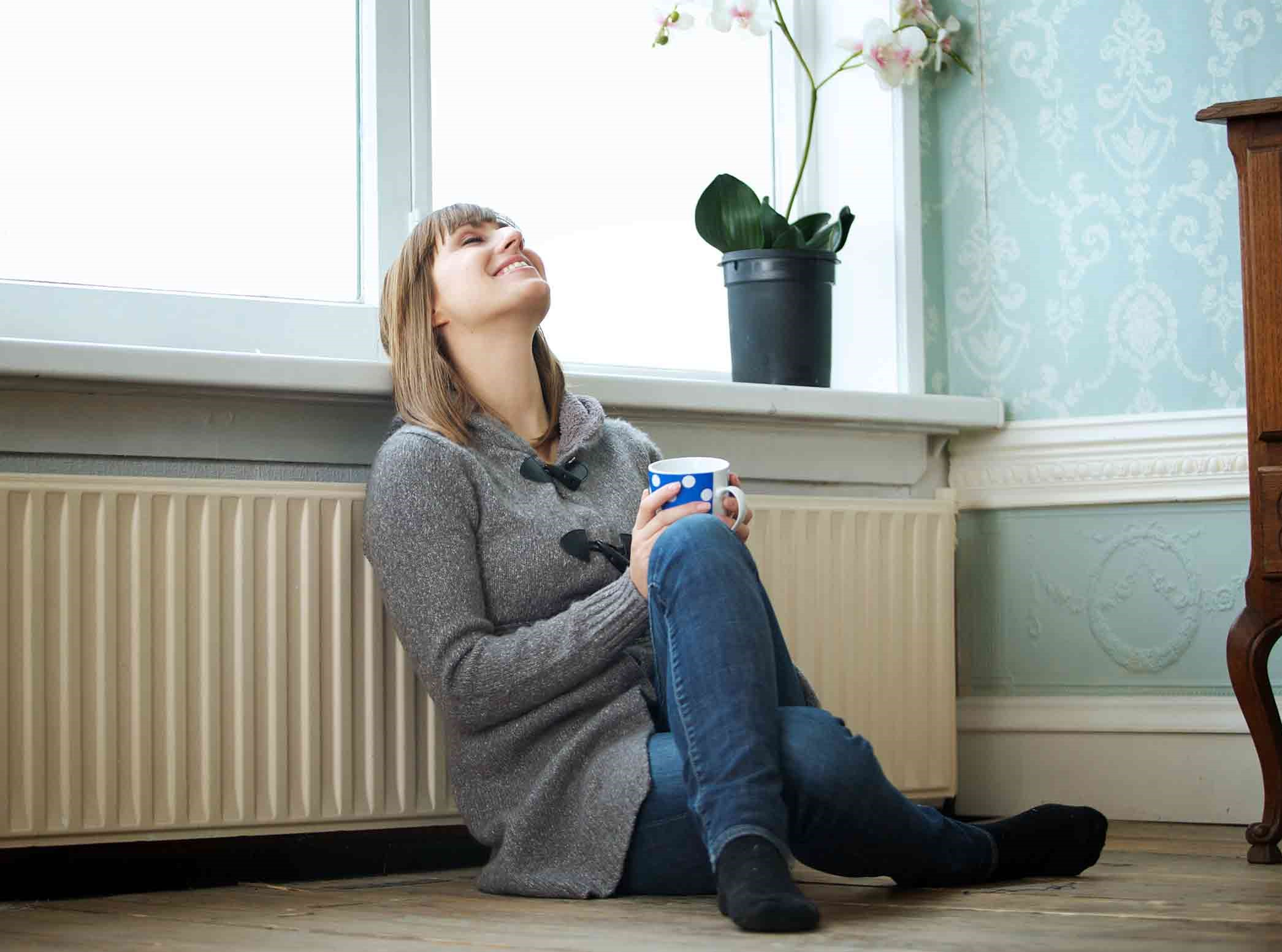 Glacier Refrigeration - Woman enjoys residential heating in Melbourne